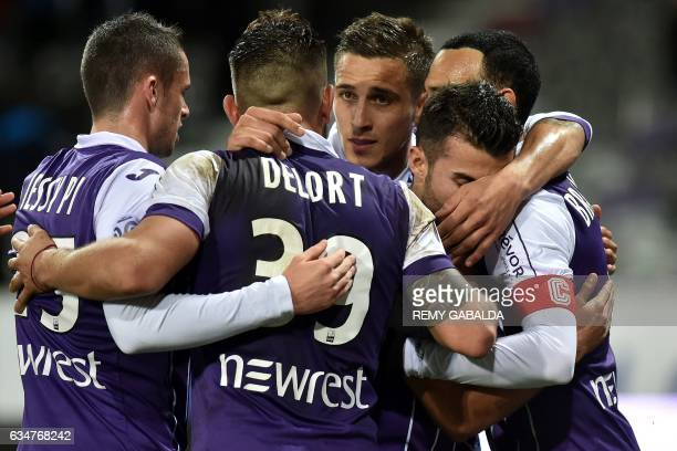 Toulouse's Danish captain and forward Martin Braithwaite celebrates with his teammates after scoring a goal during the French L1 Football match...