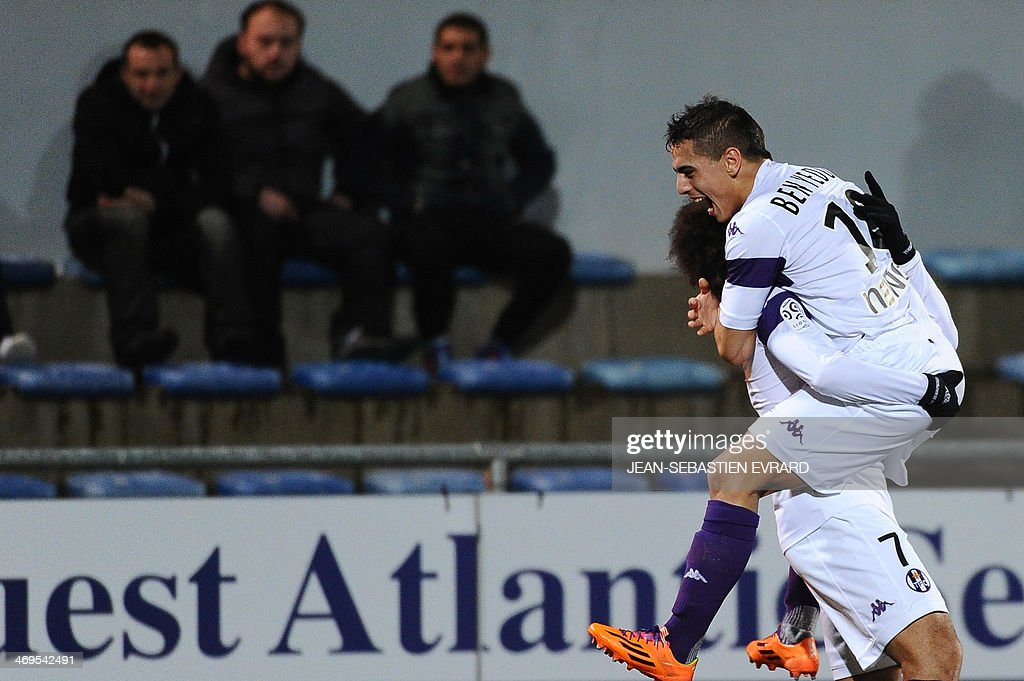 Toulouse's Danish forward Martin Braithwaite (L) celebrates after scoring a goal with his teammate Toulouse's French forward Wissam Ben Yedder during the French L1 football match between Lorient and Toulouse on February 15, 2014 at the Moustoir stadium in Lorient, western France.