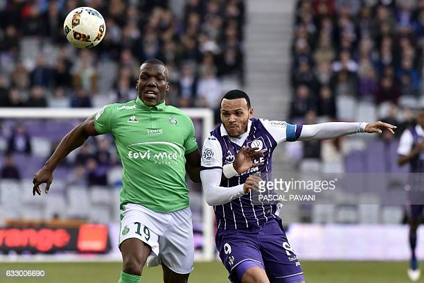 Toulouse's Danish forward Martin Braithwaite vies with SaintEtienne's French defender Florentin Pogba during the French L1 football match between...