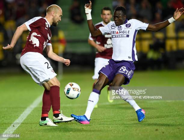 Toulouse's defender Issiaga Sylla vies with Metz' midfielder Renaud Cohade during during the French L1 football match between Metz and Toulouse on...