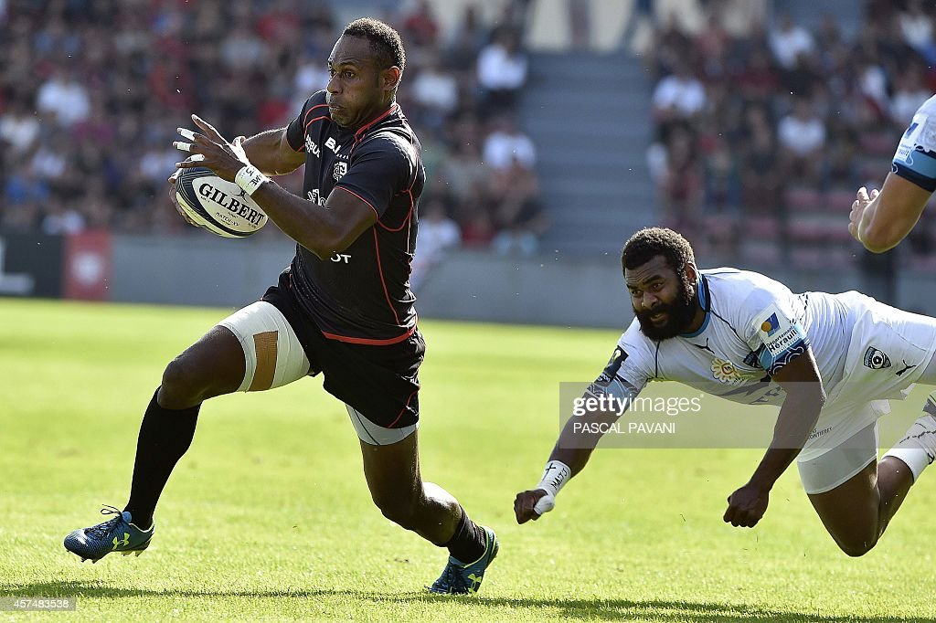 Toulouse's Fijian wing Timoci Matanavou avoids a tackle by Montpellier's Fijian wing Timoci Nagusa during the European Rugby Champions Cup match...
