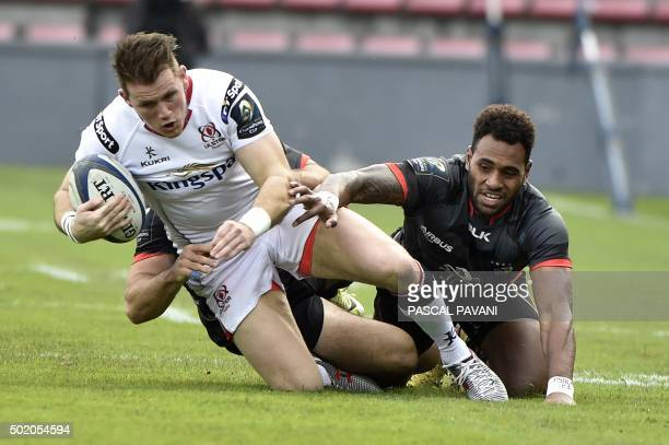 Toulouse's Fijian winger Semi Kutanami breaks away from Ulster's wing from Northern Ireland Craig Gilroy during the European Rugby Union Champions...