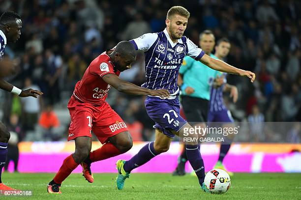 Toulouse's forward Alexis Blin runs with the ball during the French L1 football match Toulouse against Guingamp on September 17 2016 at the Municipal...