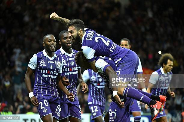 Toulouse's forward Jakub Durmaz celebrates with Toulouse's defender Moubandje Jacques after scoring a goal during the French L1 football match...