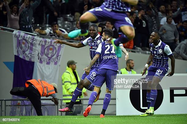 Toulouse's forward Jakub Durmaz celebrates with Toulouse's defenders Edouard Odsonne and Steeve Yago after scoring a goal during the French L1...