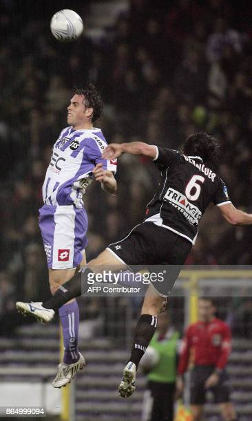 Toulouse's forward Johan Elmander vies with Nancy's midfielder Pascal Berenguer during their French L1 football match Toulouse FC vs AS NancyLorraine...