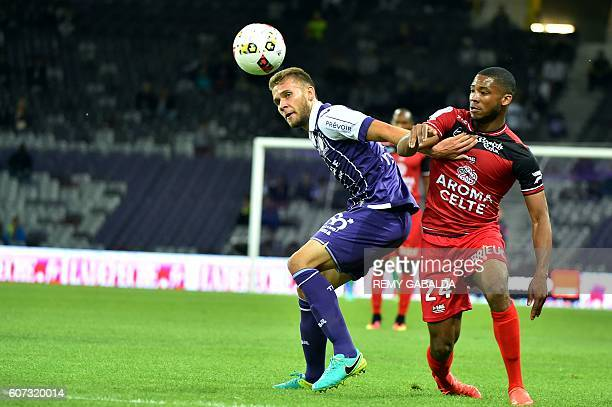 Toulouse's forwards Alexis Blin vies with Guingamp's French defender Marcus Coco during the French L1 football match Toulouse against Guingamp on...
