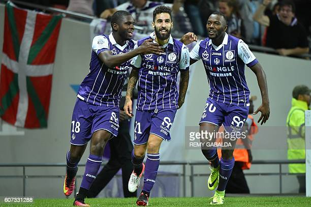 Toulouse's forwards Jakub Durmaz celebrates with Toulouse's defender Edouard Odsonne and Steeve Yago after scoring a goal during the French L1...