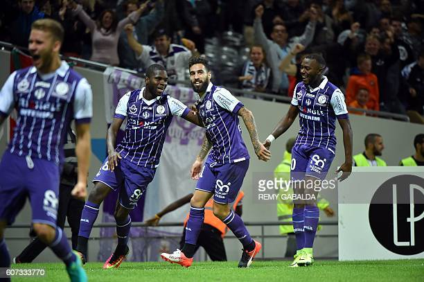 Toulouse's forwards Jakub Durmaz celebrates with Toulouse's defender Edouard Odsonne and FrenchBurkinabe defender Steeve Yago after scores a goal...