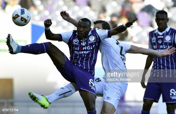 Toulouse's French Burkinabese defender Steeve Yago vies with Caen's Croatian forward Ivan Santini during the French L1 football match between...