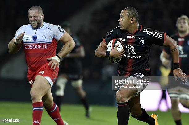 Toulouse's French centre Gael Fickou runs to score a try during the French Top 14 rugby union match Toulouse vs Grenoble on October 7 2015 at the...