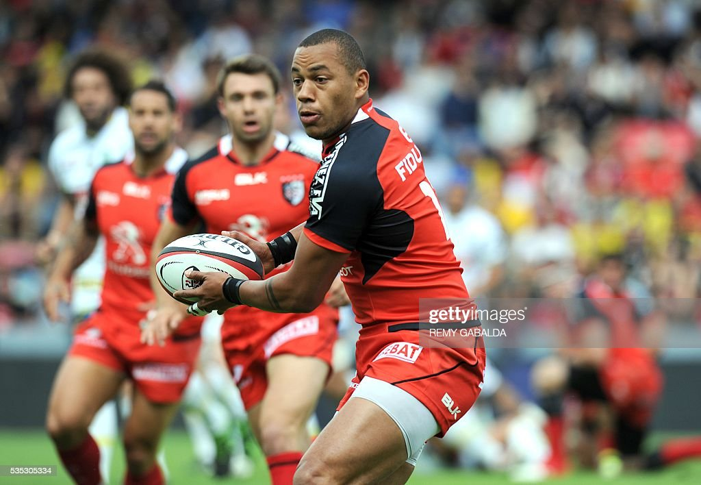 Toulouse's French centre Gael Fickou runs with the ball during the French Top 14 rugby union match Stade Toulousain versus ASM Clermont Auvergne on May 29, 2016 at the Ernest Wallon stadium in Toulouse, southern France.