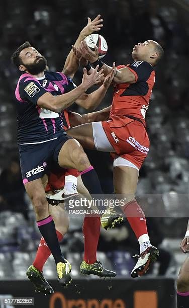 Toulouse's French centre Gael Fickou vies with Stade Francais Paris' French wing Jeremy Sinzelle during the French Top 14 rugby union match Toulouse...