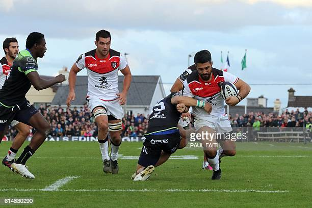 Toulouse's French centre Yann David scores their first try during the European Cup rugby union pool match between Connacht Rugby and Toulouse at The...