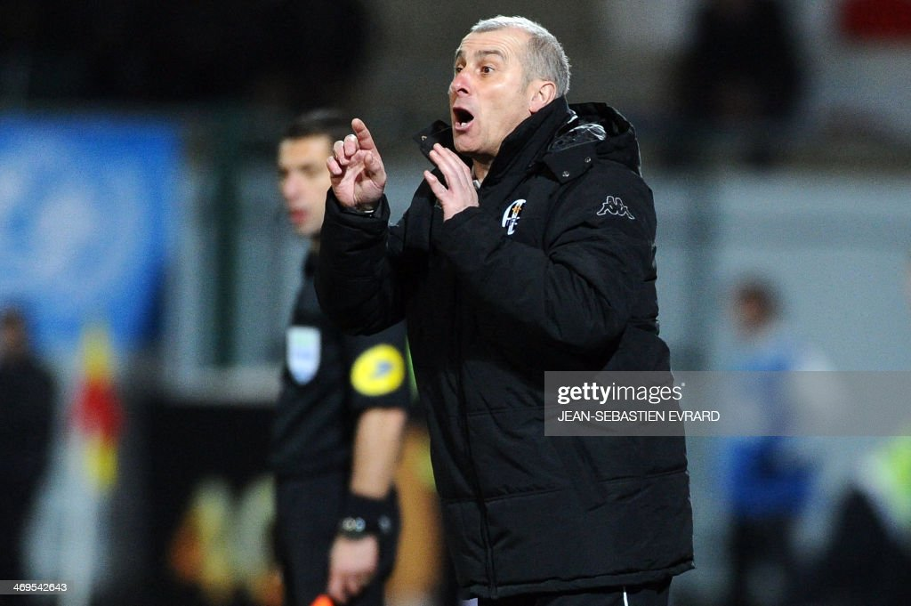 Toulouse's French coach Alain Casanova gestures during the French L1 football match between Lorient and Toulouse on February 15, 2014 at the Moustoir stadium in Lorient, western France.