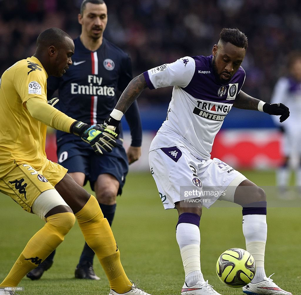 Toulouse's French Comorian goalkeeper <a gi-track='captionPersonalityLinkClicked' href=/galleries/search?phrase=Ali+Ahamada&family=editorial&specificpeople=7552244 ng-click='$event.stopPropagation()'>Ali Ahamada</a> (L) and Toulouse's defender Jean Armel Kana Biyik (R) vie with Paris Saint-Germain's Swedish forward <a gi-track='captionPersonalityLinkClicked' href=/galleries/search?phrase=Zlatan+Ibrahimovic&family=editorial&specificpeople=206139 ng-click='$event.stopPropagation()'>Zlatan Ibrahimovic</a> during the French L1 football match between Paris Saint-Germain (PSG) vs Toulouse on February 21, 2015 at the Parc des Princes stadium in Paris. AFP PHOTO / FRANCK FIFE