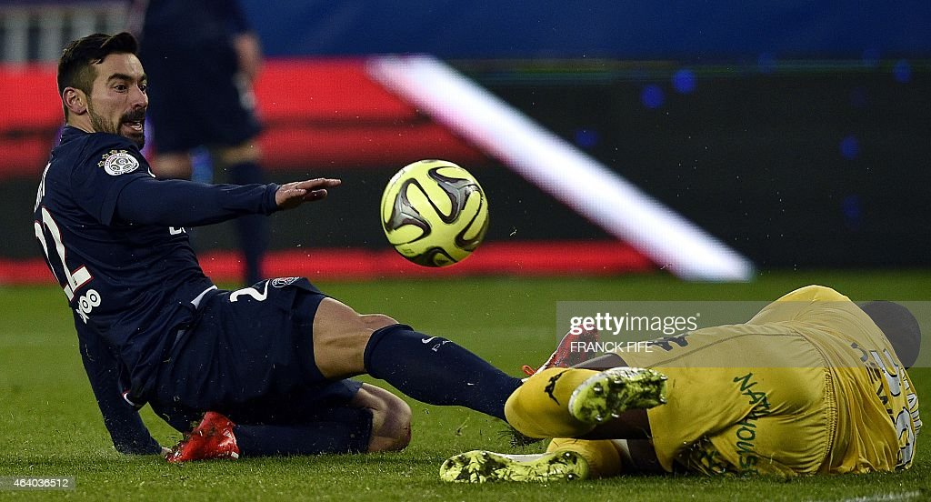 Toulouse's French Comorian goalkeeper <a gi-track='captionPersonalityLinkClicked' href=/galleries/search?phrase=Ali+Ahamada&family=editorial&specificpeople=7552244 ng-click='$event.stopPropagation()'>Ali Ahamada</a> (R) vies for the ball with Paris Saint-Germain's Argentinian midfielder <a gi-track='captionPersonalityLinkClicked' href=/galleries/search?phrase=Ezequiel+Lavezzi&family=editorial&specificpeople=5451126 ng-click='$event.stopPropagation()'>Ezequiel Lavezzi</a> during the French L1 football match between Paris Saint-Germain (PSG) and Toulouse (TFC) on February 21, 2015 at the Parc des Princes stadium in Paris. AFP PHOTO / FRANCK FIFE