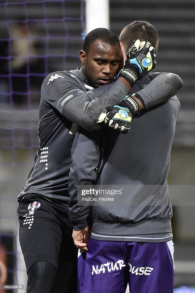 Toulouse's French Comorian goallkeeper <a gi-track='captionPersonalityLinkClicked' href=/galleries/search?phrase=Ali+Ahamada&family=editorial&specificpeople=7552244 ng-click='$event.stopPropagation()'>Ali Ahamada</a> hugs a teammate as they warm up before the French L1 football match between Toulouse and Rennes at the Municipal Stadium in Toulouse on February 14, 2015. AFP PHOTO / PASCAL PAVANI