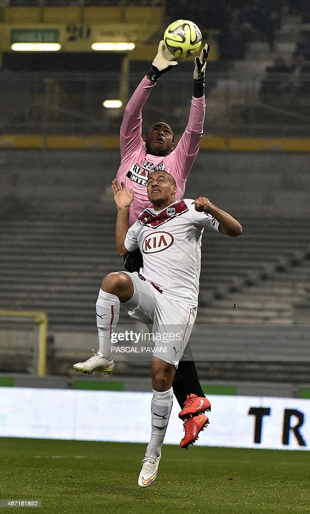 Toulouse's French Comorian goallkeeper <a gi-track='captionPersonalityLinkClicked' href=/galleries/search?phrase=Ali+Ahamada&family=editorial&specificpeople=7552244 ng-click='$event.stopPropagation()'>Ali Ahamada</a> vies with Bordeaux's French Tunisian midfielder Wahbi Khazri during the French L1 football match Toulouse vs Bordeaux on March 21, 2015 at the Municipal Stadium in Toulouse. AFP PHOTO/ PASCAL PAVANI