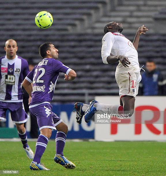 Toulouse's French defender Adil Hermach vies for the ball with Bordeaux's Malian midfielder Abdou Traore during the French L1 football match Toulouse...