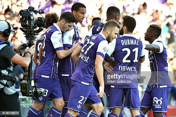 Toulouse's French defender Christopher Jullien jubilates after scoring a goal during the French Ligue 1 football match between Toulouse FC and...