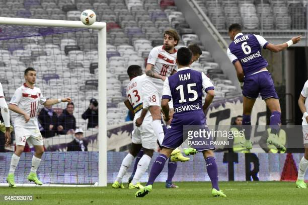 Toulouse's French defender Christopher Jullien scores a goal during the French L1 football match Toulouse against Lille on March 05 2017 at the...
