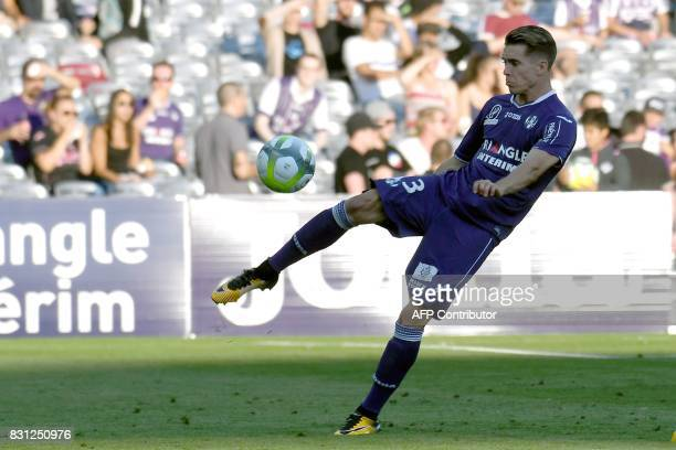 Toulouse's French defender Clement Michelin kicks the ball during the French L1 football match Toulouse FC versus Montpellier MHSC at the Municipal...