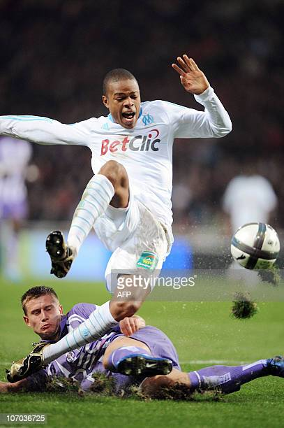 Toulouse's French defender Franck Tabanou tackles Marseille's French forward Loic Remy during their French L1 football match Toulouse vs Marseille on...