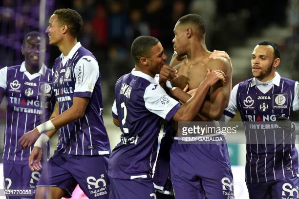 Toulouse's French defender Issa Diop celebrates with his teammates after scoring a goal during the French L1 Football match between Toulouse and...