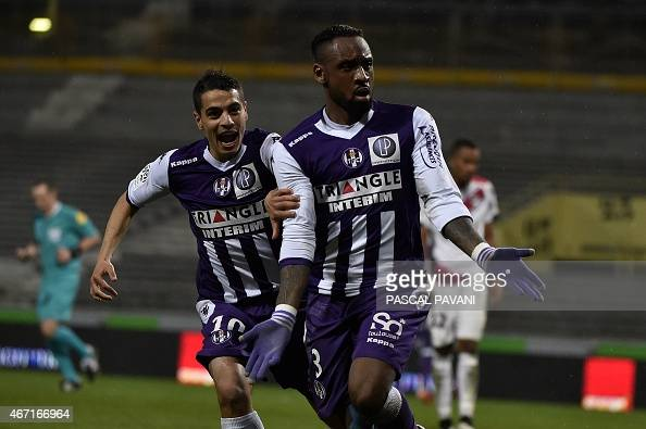 Toulouse's French defender JeanArmel Kana Biyik celebrates with teammate Toulouse's French Tunisian forward Wissam Ben Yedder after scoring a goal...