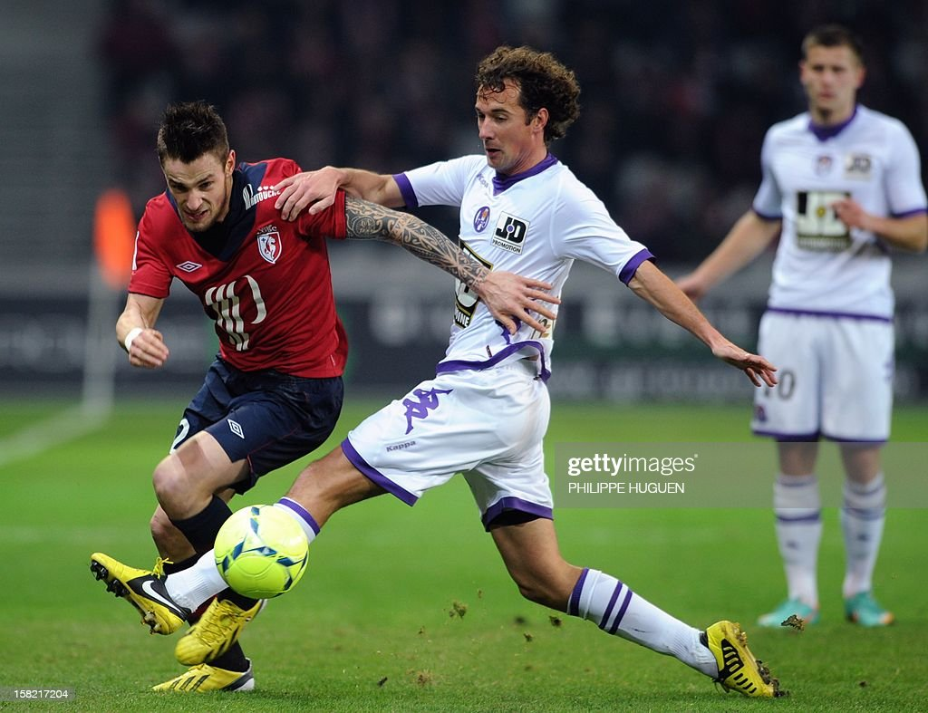 Toulouse's French defender Jean-Daniel Akpa Akpro (C) vies with Lille's French midfielder Mathieu Debuchy (L) during the French L1 football match Lille vs Toulouse on December 11, 2012 at the Grand Stade Stadium in Villeneuve d'Ascq.