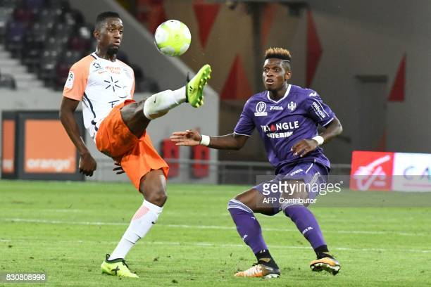 Toulouse's French defender Kelvin Amian vies with Montpellier's French forward Isaac Mbenza during the French L1 football match Toulouse against...