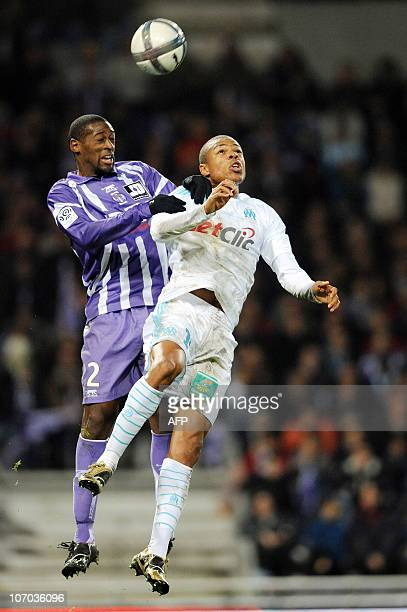 Toulouse's French defender Mohamed Fofana heads the ball despite Marseille's French forward Loic Remy during their French L1 football match Toulouse...