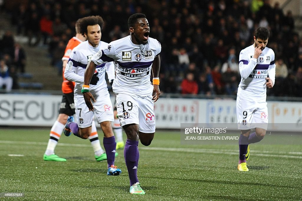 Toulouse's French defender Serge Aurier celebrates after scoring a goa during the French L1 football match between Lorient and Toulouse on February 15, 2014 at the Moustoir stadium in Lorient, western France.