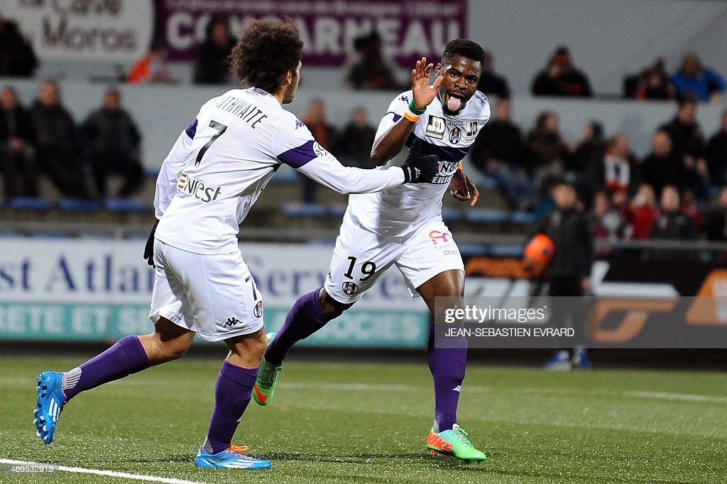 Toulouse's French defender Serge Aurier (R) celebrates after scoring a goal with his teammate Toulouse's Danish forward Martin Braithwaite during the French L1 football match between Lorient and Toulouse on February 15, 2014 at the Moustoir stadium in Lorient, western France.