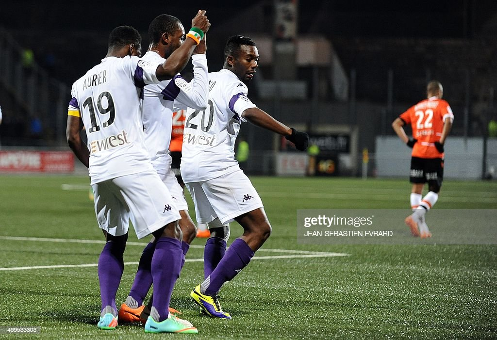 Toulouse's French defender Serge Aurier, Toulouse's French defender Jean Daniel Akpa Akpro and Toulouse's French defender Steeve Yago dance after a goal during the French L1 football match between Lorient and Toulouse on February 15, 2014 at the Moustoir stadium in Lorient, western France.