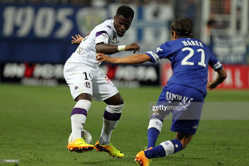 Toulouse's French defender Serge Aurier vies with Bastia's Algerian defender Fethi Harek during the French L1 football match Bastia against Toulouse...