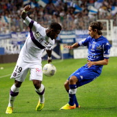 Toulouse's French defender Serge Aurier vies with Bastia's Algerian defender Fethi Harek during the French L1 football match Bastia vs Toulouse in...