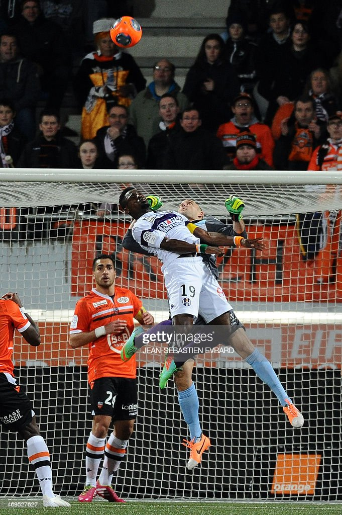 Toulouse's French defender Serge Aurier (L) vies with Lorient's French goalkeeper Fabien Audard during the French L1 football match between Lorient and Toulouse on February 15, 2014 at the Moustoir stadium in Lorient, western France.