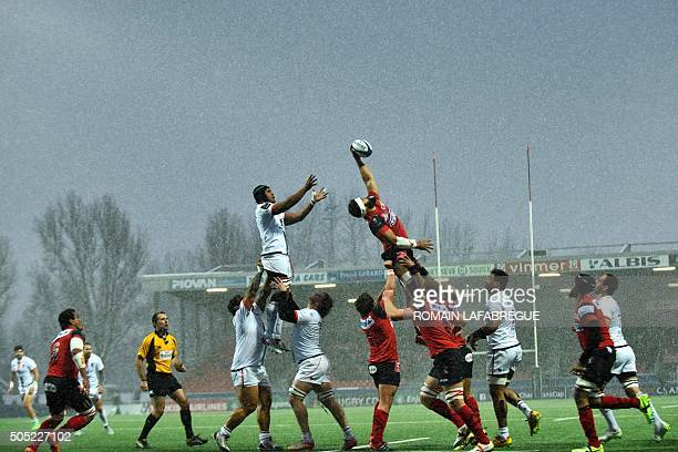 Toulouse's French flanker Thierry Dusautoir jumps to catch the ball from a line out during the European Champions Cup rugby union match between...