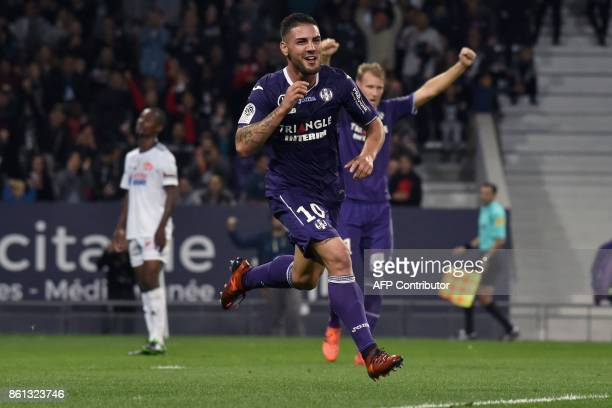 Toulouse's French forward Andy Delort celebrates after scoring a goal during the French L1 football match Toulouse against Amiens October 14 2017 at...