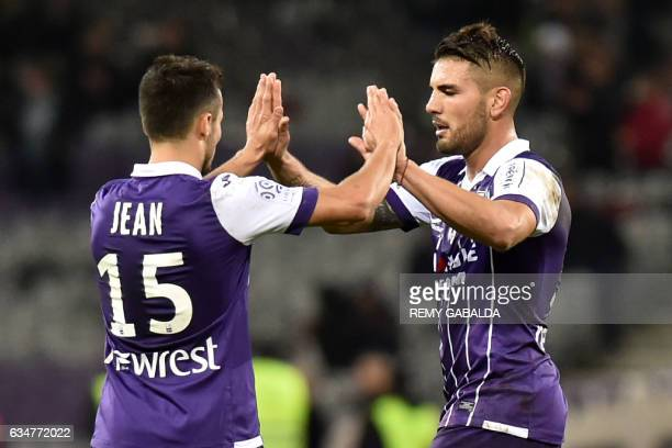 Toulouse's French forward Andy Delort celebrates with teammate French forward Corentin Jean after winning the French L1 Football match between...