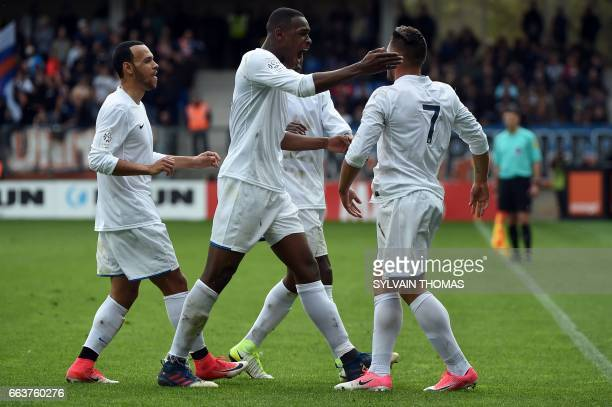 CORRECTION Toulouse's french forward Andy Delort celebrates with teammates after scoring a goal during the French L1 football match between between...