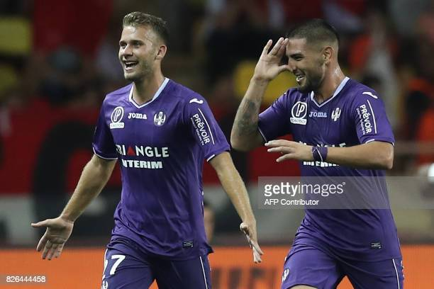 Toulouse's French forward Andy Delort celebrates with Toulouse's French midfielder Alexis Blin after scoring a goal during the French L1 football...