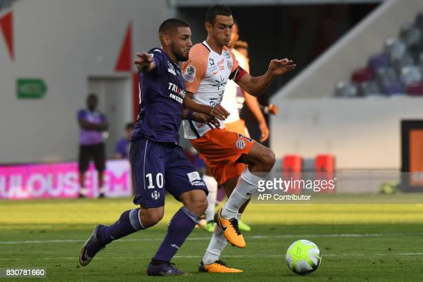 Toulouse's French forward Andy Delort fights for the ball with Montpellier's French forward Jonathan Ikone during the French L1 football match...