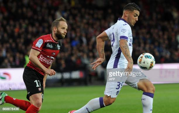 Toulouse's French forward Andy Delort outruns Guingamp's French midfielder Etienne Didot during the French Ligue 1 football match Guingamp vs...