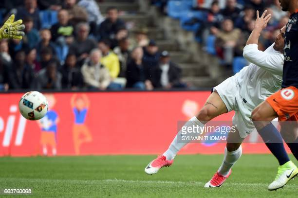 CORRECTION Toulouse's french forward Andy Delort scores a goal during the French L1 football match between between Montpellier and Toulouse on April...