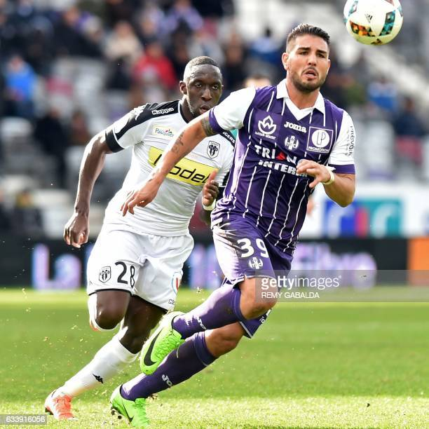 Toulouse's French forward Andy Delort vies with Angers' Senegalese defender Issa Cissokho during the French L1 football match between Toulouse and...