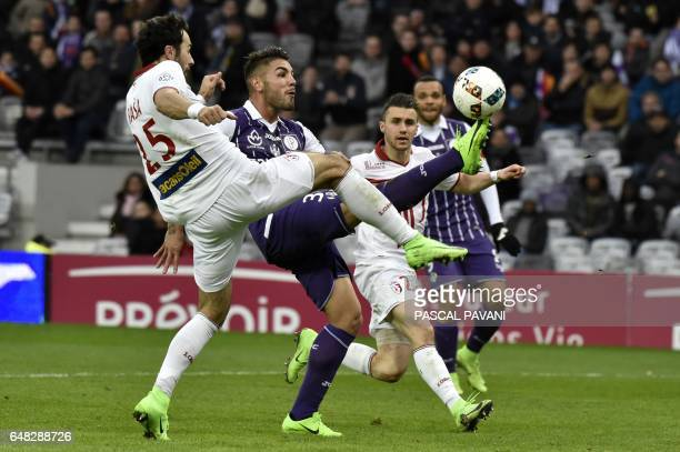 Toulouse's French forward Andy Delort with Lille's French forward Naim Slitt during the French L1 football match between Toulouse against Lille on...