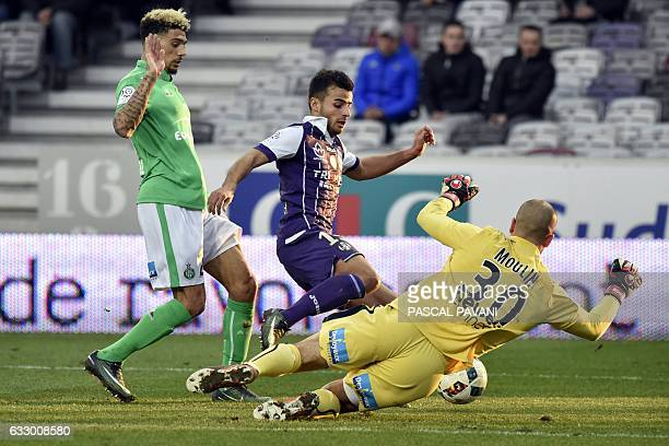 Toulouse's French forward Corentin Jean vies with SaintEtienne's French defender Kevin Malcuit and SaintEtienne's French goalkeeper Jessy Moulin...